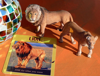 lion symbols, signs, oracle card spiritual meaning